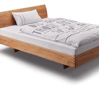 Step-X Bett mit Holzkufe und geschwungenem Kopfteil